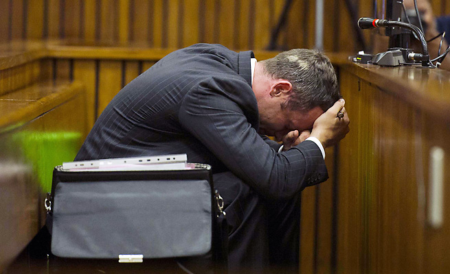 Oscar Pistorius did not watch as images of blood spatter in his house were shown in court Thursday.