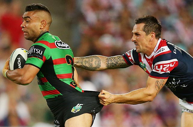 Nathan Merritt of the Sydney Rabbitohs is halted by a traditional flying wedgie expertly executed by Mitchell Pearce of the Sydney Roosters during their round one match in Sydney, Australia.
