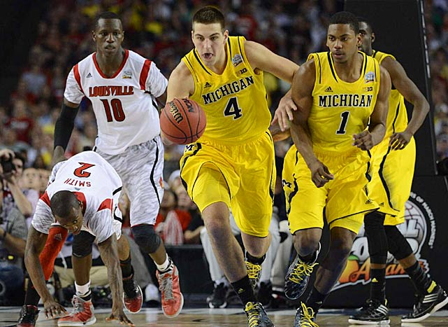 Leading Scorer: Nick Stauskus (17.5 ppg.) Leading Rebounder: Mitch McGary (8.3 rpg., pictured) Leading Passer: Nick Stauskus (3.3 apg.) Bad Losses: @ Indiana Good Wins: Wisconsin, Iowa, Michigan State, Ohio State (twice)