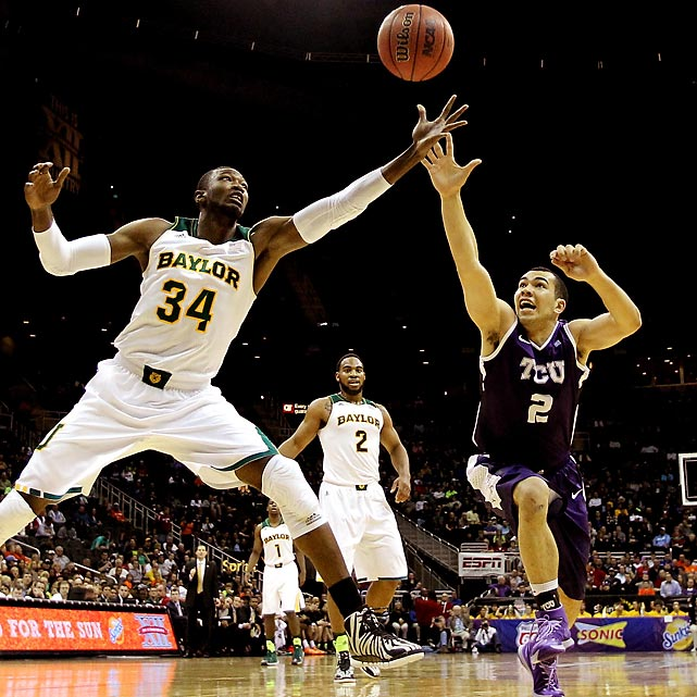 Baylor's Cory Jefferson and TCU's Michael Williams reach for a loose ball during a first-round game of the Big 12 Tournament. The Bears claimed a 76-68 win.