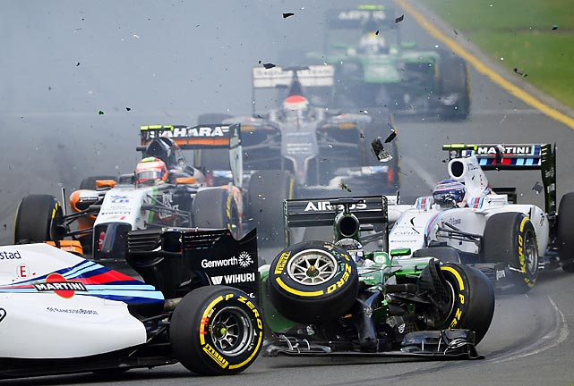 Brazil's Felipe Massa and Japan's Kamui Kobayashi collide on the first turn of the first lap of the Australian Formula One Grand Prix in Melbourne on Sunday. Massa and Kobayashi walked away from the accident.