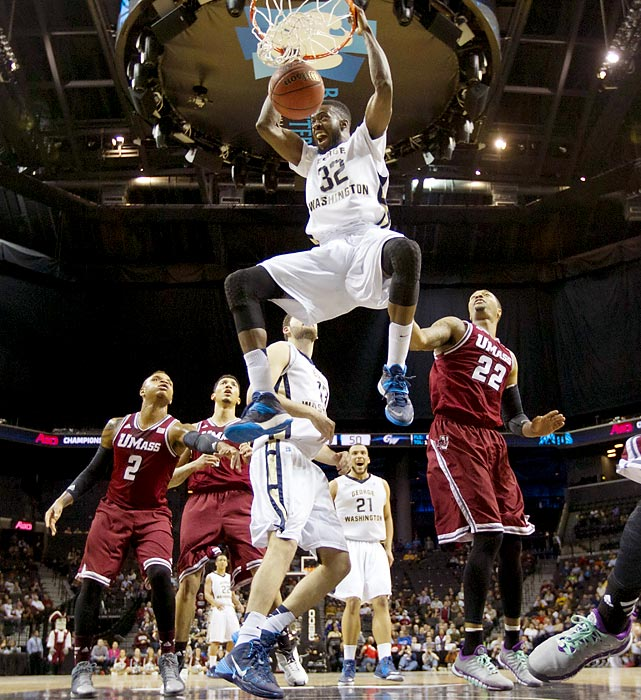 George Washington's Isaiah Armwood dunks in an Atlantic 10 Tournament quarterfinal game against UMass. Armwood led the Colonials with 15 points, helping his team claim an 85-77 victory.