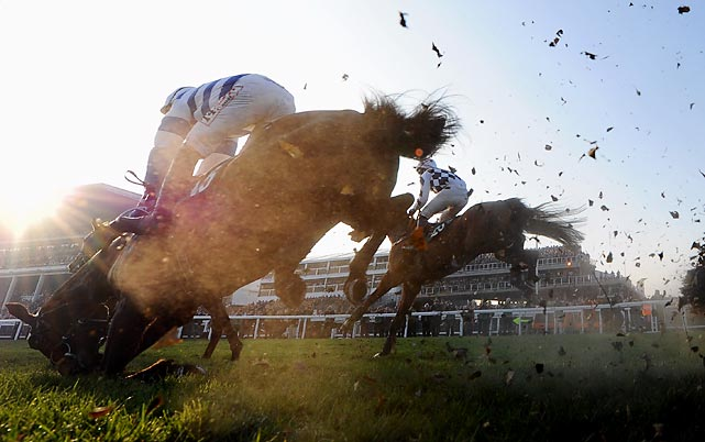 Jockey Wayne Hutchinson and his horse Atre de la Cour fall during the Fred Winter Juvenile Handicap Hurdle at Cheltenham Racecourse.