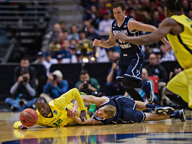 Jason Calliste of Oregon and Tyler Haws of BYU scramble for a loose ball.
