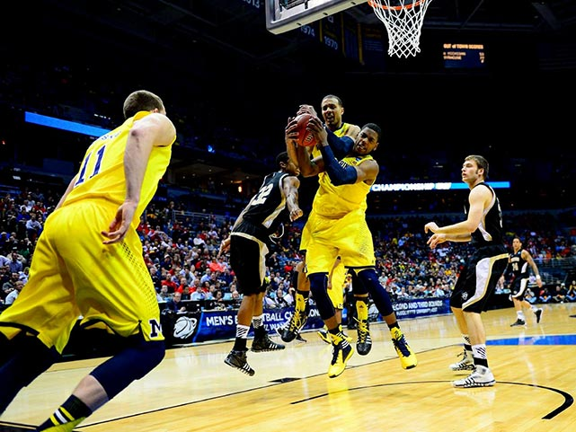 Glenn Robinson III and Jordan Morgan battle for the same rebound in a game that Michigan won primarily with its defense.