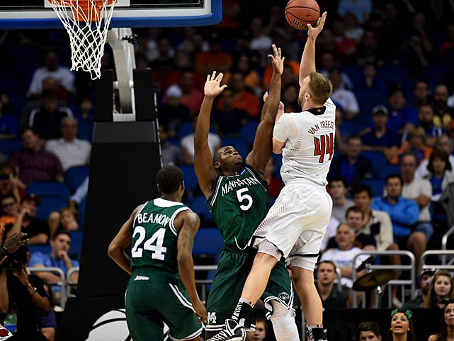 Stephan Van Treese shoots over Rhamel Brown during Louisville's win.