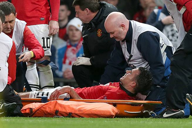 Manchester United's Robin van Persie was stretchered off the field Wednesday after scoring a hat trick against Olympiakos to keep the Red Devils alive in the Champions League.