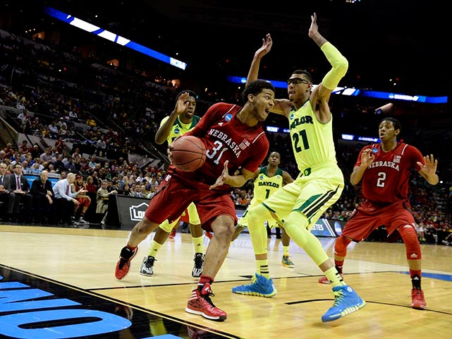Isaiah Austin (21) and the Bears held Shavon Shields (31) and the Cornhuskers to a mere 16 points in the first half.