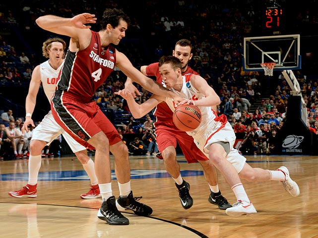 Cullen Neal is defended by Stefan Nastic in a game in which the Cardinal built an early 16-point lead then held on after New Mexico rallied to tie it midway through the second half.