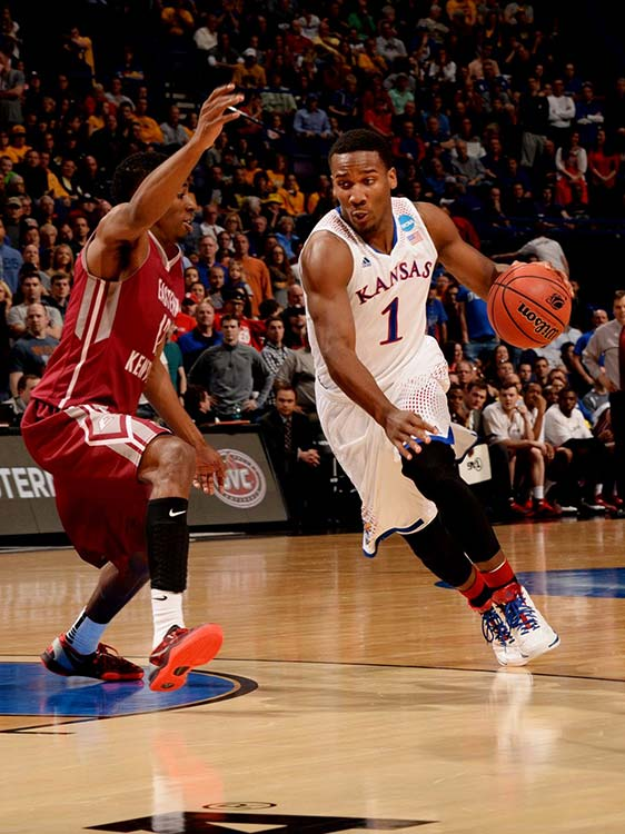 Marcus Lewis defends against Wayne Selden Jr. in a game that Eastern Kentucky led 56-53 with 9:11 to go.