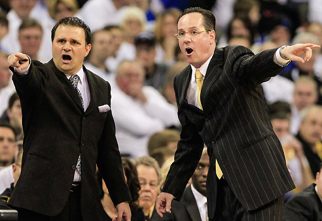 Chris Jans (L) shouts out directions alongside head coach Gregg Marshall of Wichita State.