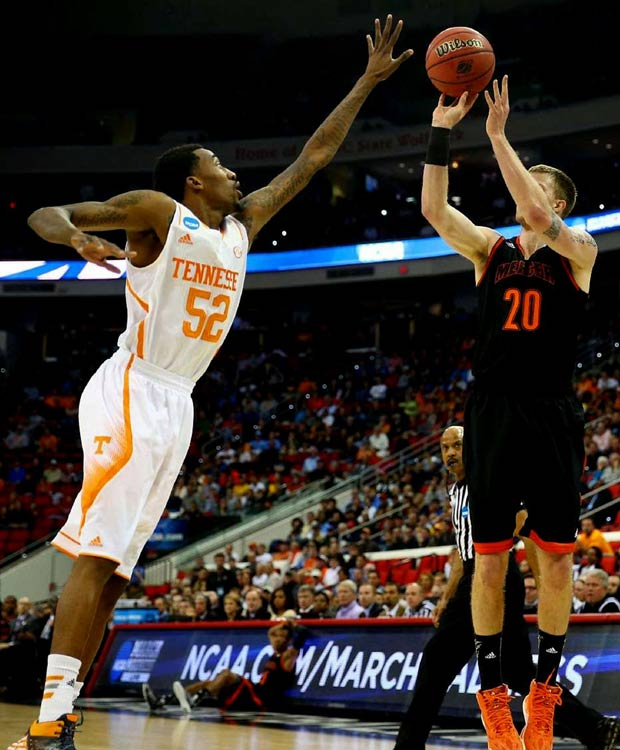 Jakob Gollon attempts to get a shot off before Jordan McRae can block it. Mercer, which knocked off Duke on Friday, had no answer for Tennessee's size on Sunday.