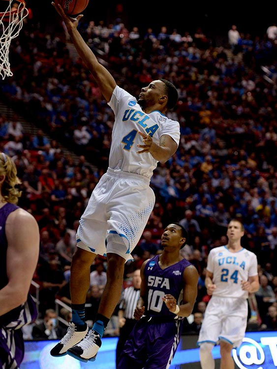 Norman Powell scores two of his 16 points as UCLA punched its way to the Sweet 16 and a matchup against Florida.