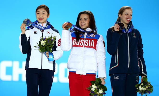 Yuna Kim (left) earned a silver, while judges awarded Russian skater Adelina Sotnikova the gold.