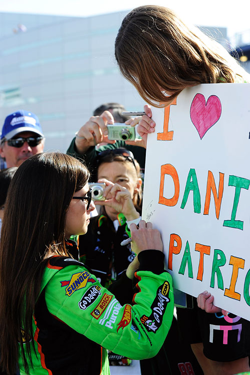 Danica signs a fan's poster during qualifying for the NASCAR Nationwide Series Sam's Town 300 at Las Vegas Motor Speedway.