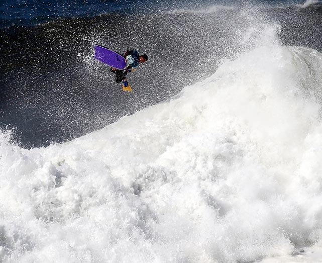 A bodyboarder goes airborne in a contest being held at the North beach, outside the fishing village of Nazare.