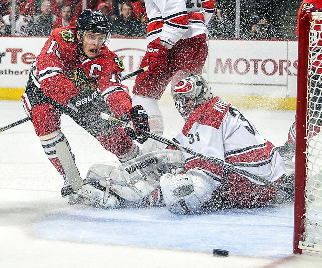 Chicago Blackhawk Jonathan Toews battles with Carolina Hurricanes goalie Anton Khudobin. The Blackhawks won 3-2.