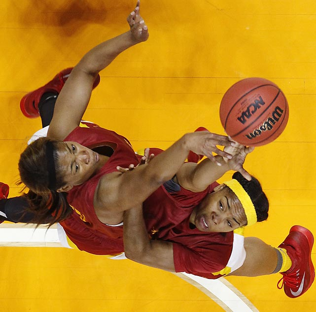 Southern California's Kaneisha Horn (left) and Brianna Barrett battle under the basket during practice on March 21 in Knoxville.