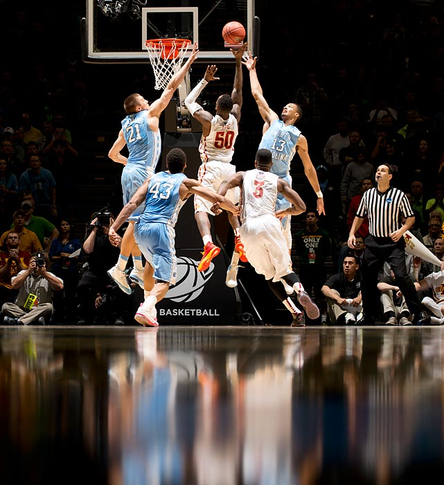 Iowa State DeAndre Kane goes in for a layup against North Carolina's J.P. Tokoto (13) and Jackson Simmons (21).