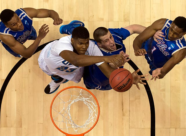 UCLA's Tony Parker goes up against Tulsa's Lew Evans and Rashad Smith in round one.