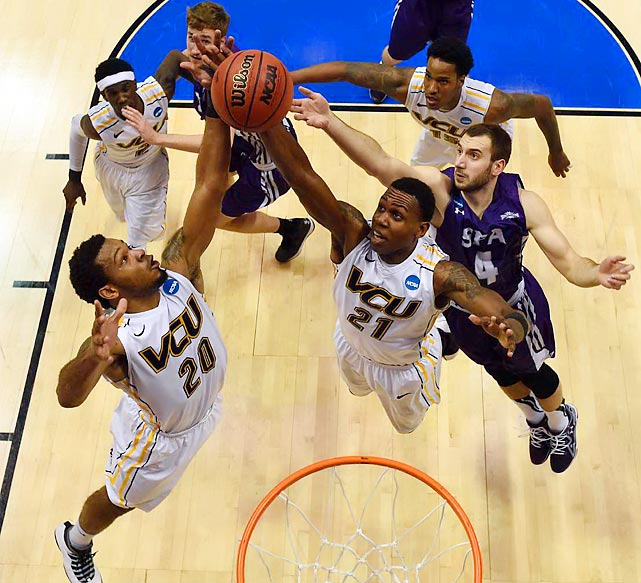 VCU's Jordan Burgess (20) and Treveon Graham grab the rebound from Stephen F. Austin's Nikola Gajic (4) in round one. The Lumberjacks knocked off VCU.