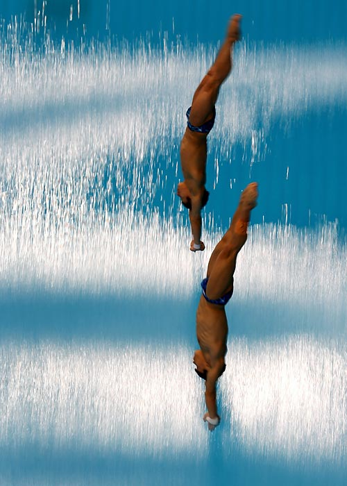 Yuan Cao and Yue Lin of China dive in the Synchro Springboard Final in Dubai.