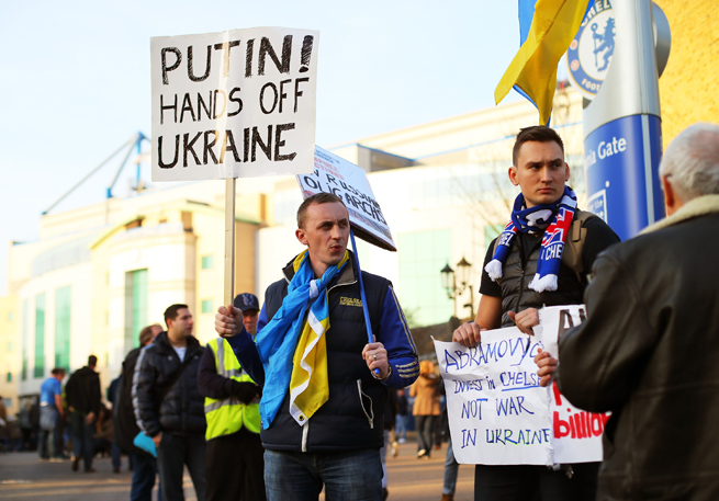 A Ukraine supporter outside of a Chelsea-Tottenham clash earlier in March voices his opposition to Russia president Vladimir Putin.