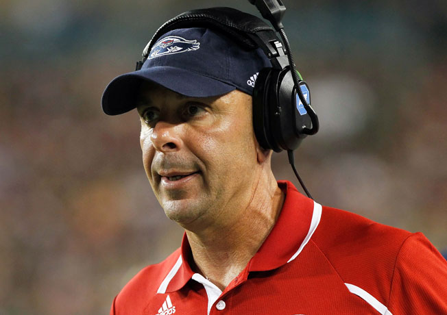 Carl Pelini was fired as FAU's coach last October for failing to 'timely report' conduct of a staff member.