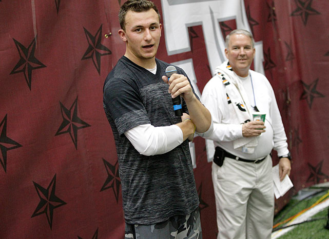 Manziel wore camouflage shorts and spoke with those in attendance from the NFL before the workout started, to introduce the teammates to whom he'd be throwing. Former President George HW Bush and wife Barbara were in attendance, as was current Texas governor Rick Perry. Representatives from the Texans, Jaguars, Raiders, Vikings and Eagles ? among others ? were also in attendance, adding a football-like feel to the opening ceremonies, as well.