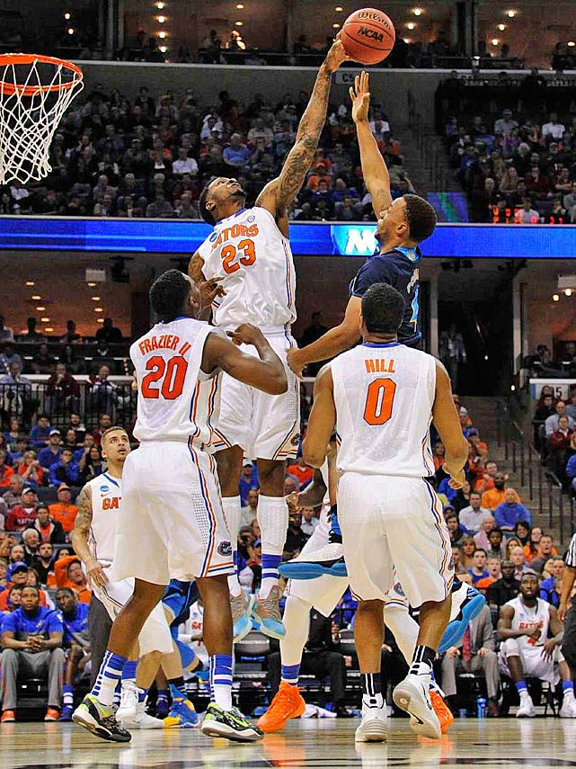 Florida's Chris Walker blocks a shot by UCLA guard Norman Powell as Florida advanced to face Dayton on Saturday.
