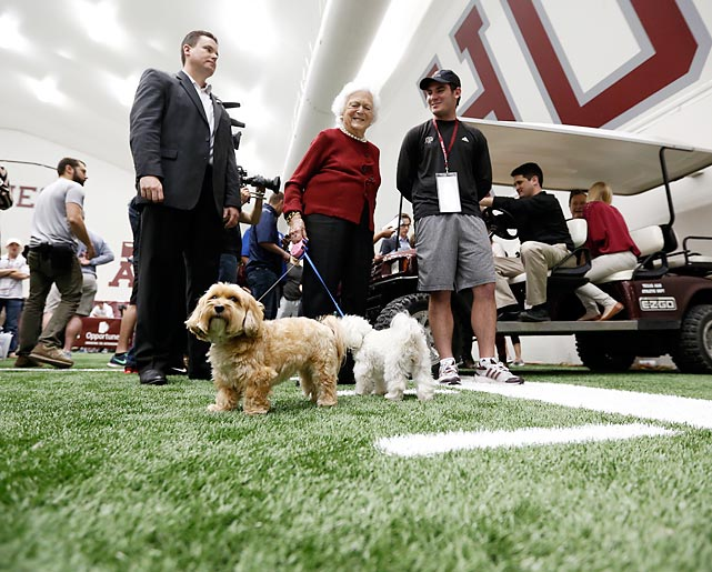 According to reports from our spies, Johnny aced the dog-walking and pooch punt portion of his session in College Station, Texas. The canines were kindly provided by the former First Lady.