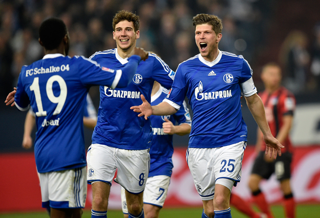 Schalke's Klaas-Jan Huntelaar, right, celebrates his goal with teammates Leon Goretzka, center, and Chinedu Obasi, left, during a 2-0 win over Hertha Berlin.