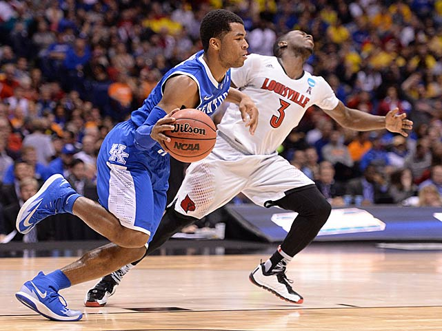 Andrew Harrison dribbles past Chris Jones as Kentucky eliminated the defending national champions.