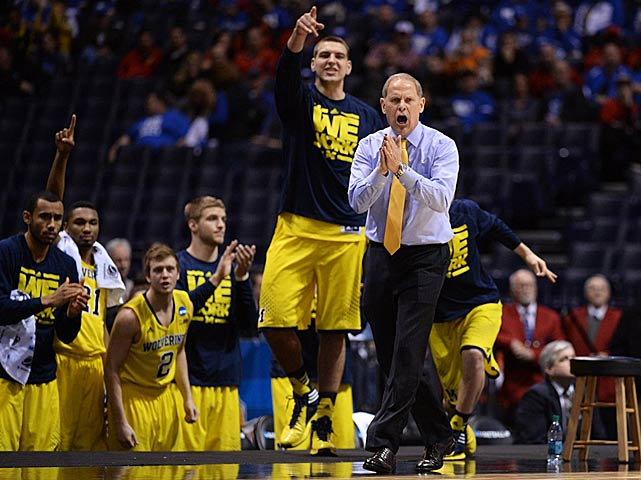 Michigan coach John Beilein urges on his team.