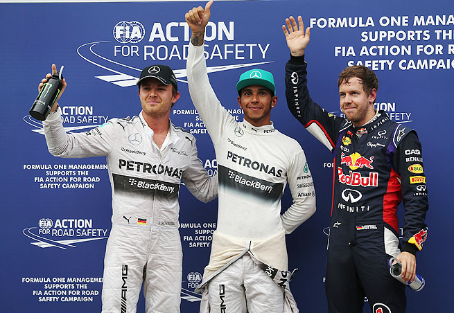 Vettel (right) blamed Rosberg (left) for his runner-up finish to Hamilton (center) in qualifying.