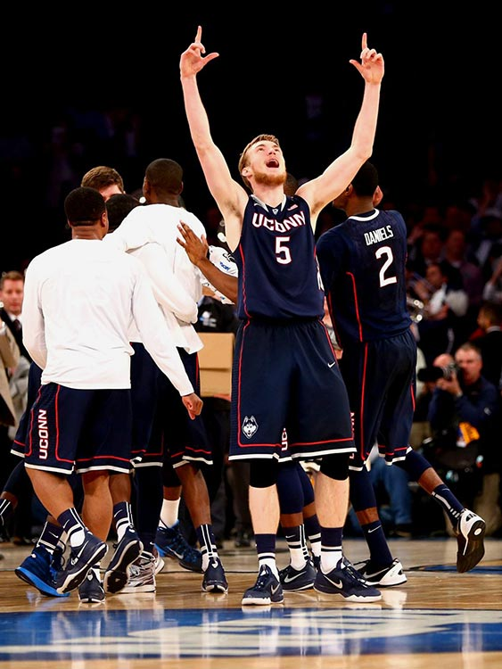 <italics>SI's best shots of the regional finals, in which the Final Four pairing of Florida, Connecticut, Kentucky and Wisconsin was produced.</italics> Niels Giffey celebrates UConn's victory over Michigan State, which made the Huskies the first No. 7 seed to reach the Final Four since the tournament expanded to 64 teams in 1985.