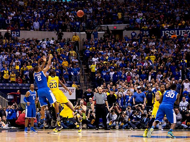 Aaron Harrison nailed this three-point shot from NBA range with 2.3 seconds left to lift Kentucky into the Final Four. He scored 12 points off four three-pointers over the last 8:05.