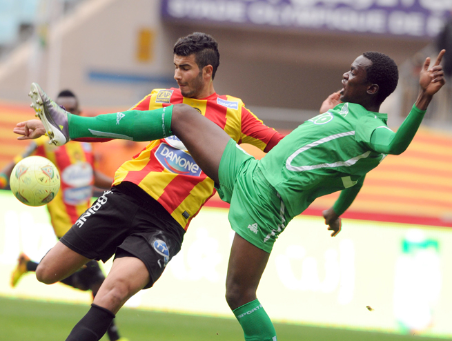 Gor Mahia FC defender Musa Mohamed, right, vies for the ball with Esperance of Tunis Striker Haythem Juini during an African Champions League match last month.