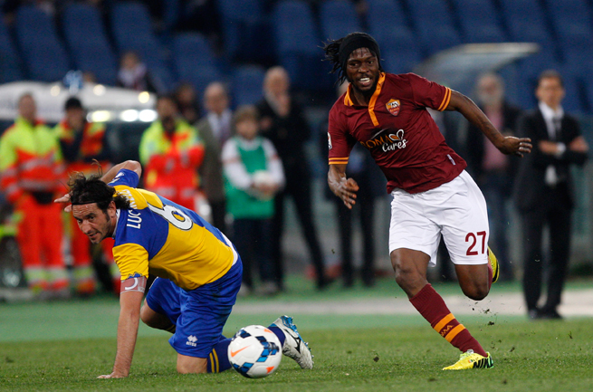 Roma's Gervinho, left, dribbles by Parma's Alessandro Lucarelli during Wednesday's 4-2 win in Italy.