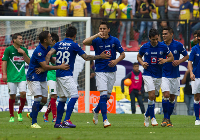 Cruz Azul's Julio Cesar Dominguez, center, celebrates after scoring against Club America over the weekend.