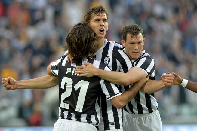 Juventus' Fernando Llorente gets sandwiched by Andrea Pirlo, left, and Stephan Lichtsteiner after scoring one of his two goals against Livorno on Monday.