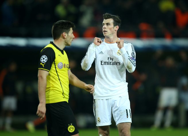 Gareth Bale, right, celebrates at the final whistle, with Real Madrid advancing in the Champions League despite a 2-0 second-leg loss to Borussia Dortmund in Germany.