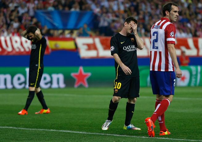 Atletico Madrid's Diego Godin frustrated Cesc Fabregas, left, and Lionel Messi, center, with Atleti eliminating Barcelona from the Champions League.