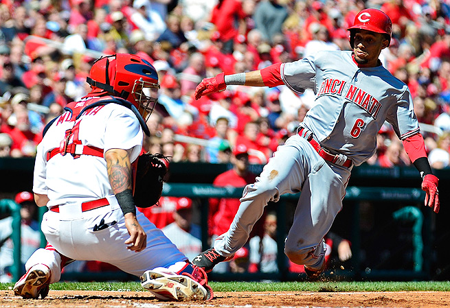 Billy Hamilton slides safely past Yadier Molina to score in the fifth inning. The Reds beat the Cardinals 4-0.
