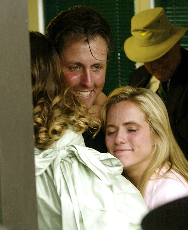 Phil Mickelson celebrates his Masters win with wife Amy and daughter Amanda in the scoring shack on April 11, 2004.