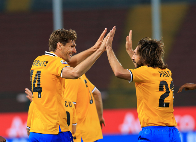 Juventus' Fernando Llorente, left, celebrates his goal with Andrea Pirlo during the club's 2-0 win over Udinese on Monday.