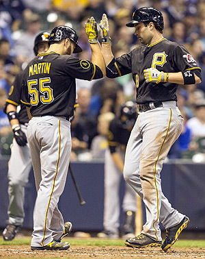 Neil Walker smashed two home runs in a (rain-shortened) slugfest against the Reds.