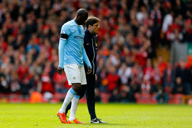 Manchester City midfielder Yaya Toure walks off the field against Liverpool hurt in Sunday's 3-2 loss at Anfield.