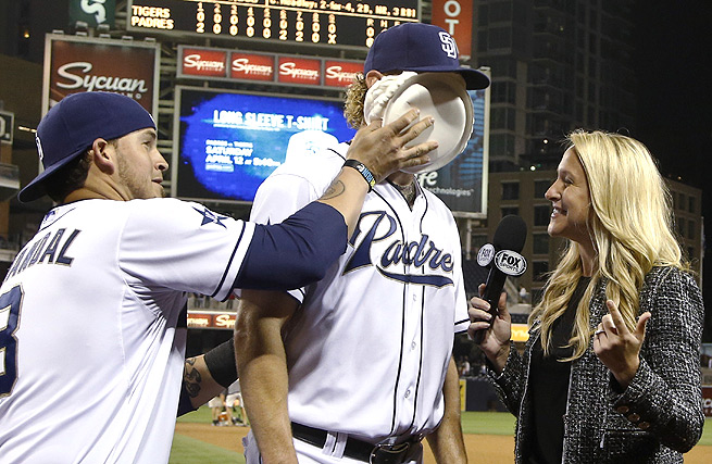 Andrew Cashner gets a shaving-cream pie to the face after pitching a one-hit shutout against the Tigers.