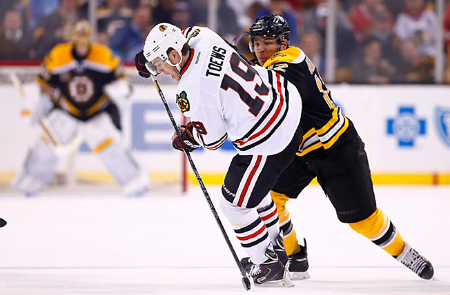 Jonathan Toews (19) and the Blackhawks defend their Cup, while Jarome Iginla (12) seeks his first.